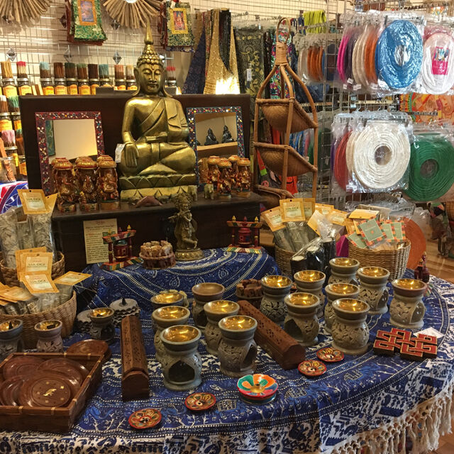 Various indie items laid out in store, with a bronze buddha