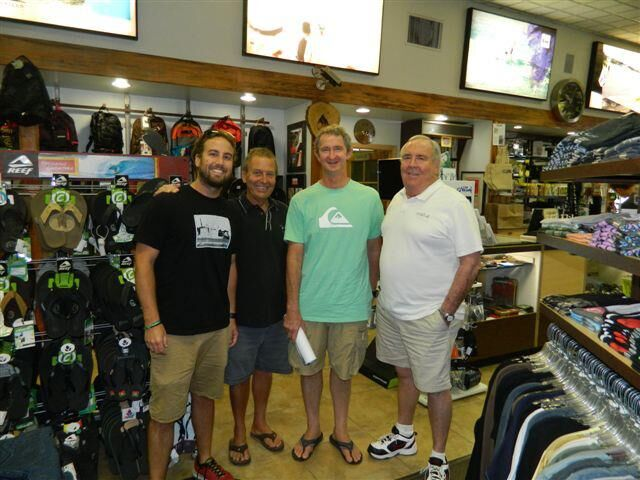 Val Surf customers and employees inside the shop, surrounded by flip-flops and other surf apparel