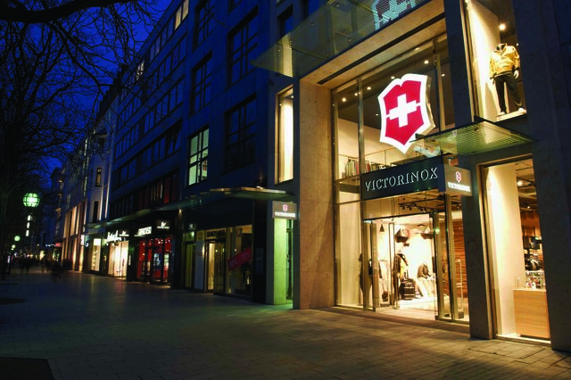 Entrance to Victorinox store viewed on at an angle on a posh street at night