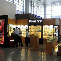 Very well-lit glass cabinet display of high-end pens