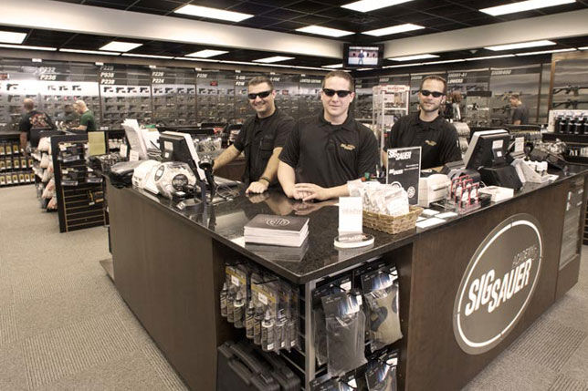 Owners and employees showcasing their pristine store.