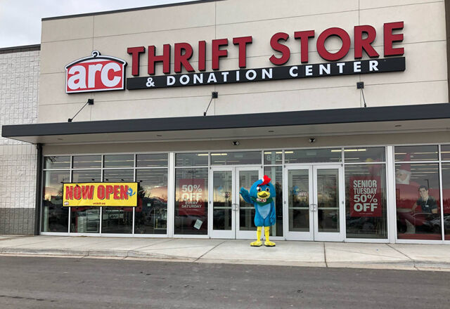 Arc Thrift store front with mascot