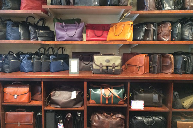 London Harness rackspace of high-end luxury bags and suitcases
