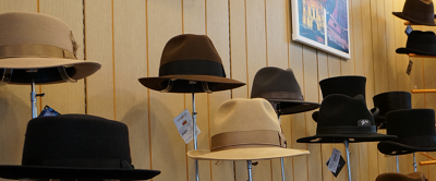 Interior view of many old fashioned stylish hats on display